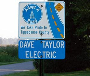 Roadsign showing that Dave Taylor Electric has Adopted a Road